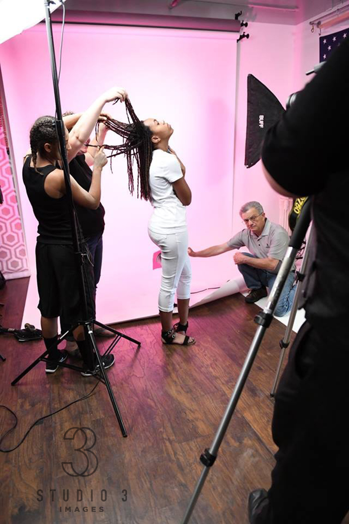 - A behind the scenes (BTS) image from Heidi and Andrew's Super 1 Day workshop, demonstrating how to incorporate colored gels and dynamic posing to craft something more than an ordinary image.