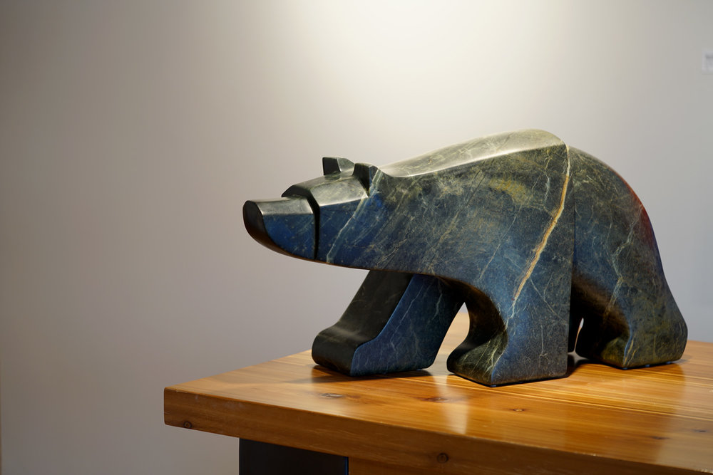 "The Rather Large Walking Bear Walks   Canadian Soapstone  11"" W x 31"" L x 16"" H  Jason Carter, 2018  $17,950"