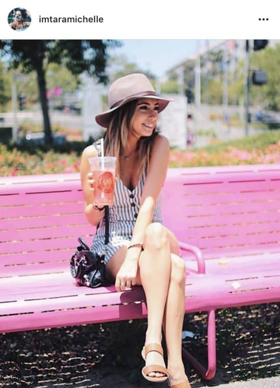 Los Angeles, California - I LOVE the romper I'm wearing in this picture, it's so comfy and still looks perfect for any occasion! We went to Grand park for a little walk downtown and they have these bright pink benches and picnic tables across the park! Absolutely adorable and definitely calls for an Instagram picture!Romper – Urban OutfittersShoes – Macy'sHat – H&M (similar)Bag – Balenciaga