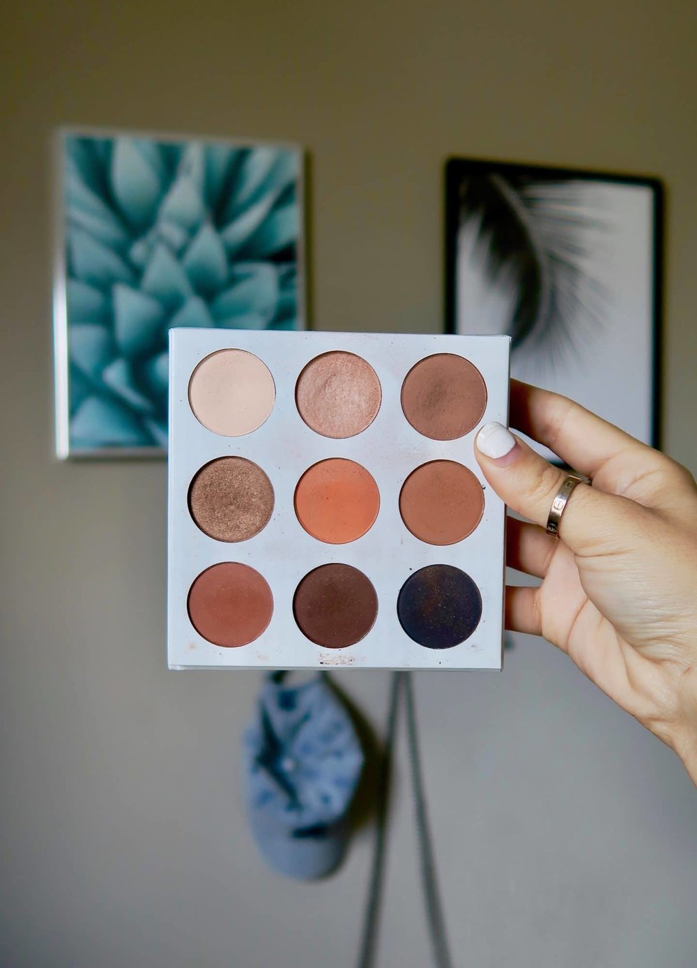 When I first got this palette, I was OBSESSED. - I've always been more of a cool-toned brown kinda girl and this palette is definitely on the warmer end, which was an adjustment for me at first. It has 9 beautiful shades and I used it consistently for the first couple months of owning it. I recently picked it back up after watching a gorgeous makeup tutorial, and I'm re-obsessed with it.I've never been a professional makeup artist, nor will I ever be… but I've discovered a new love for a good blending shade. There is a bright orange color in this palette that I NEVER got near, mostly because I was intimidated. Turns out that it actually doesn't look crazy when you apply it and it creates a really nice blended look at the end! Therefore, I highly recommend you guys try something a little more bold next time you're playing around with makeup. Maybe you'll end up loving what you end up with!