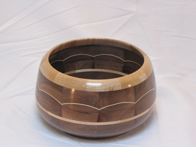 Segmented bowl made from figured maple, bloodwood, and walnut.