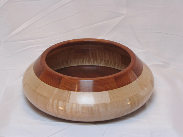 Segmented bowl made from bloodwood and figured maple.