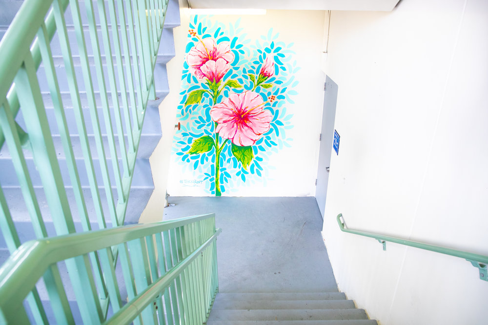 growing good - SARAH LAPIERREThis is a 3 part mural series, with a blooming flower that corresponds with each of the garages: Hibiscus, Gardenia, and Sapodilla, created with good vibes and lots of vibrant uplifting colors to make any passer by feel a little brighter.Location: Hibicus Garage, Gardenia Garage & Sapodilla Garage