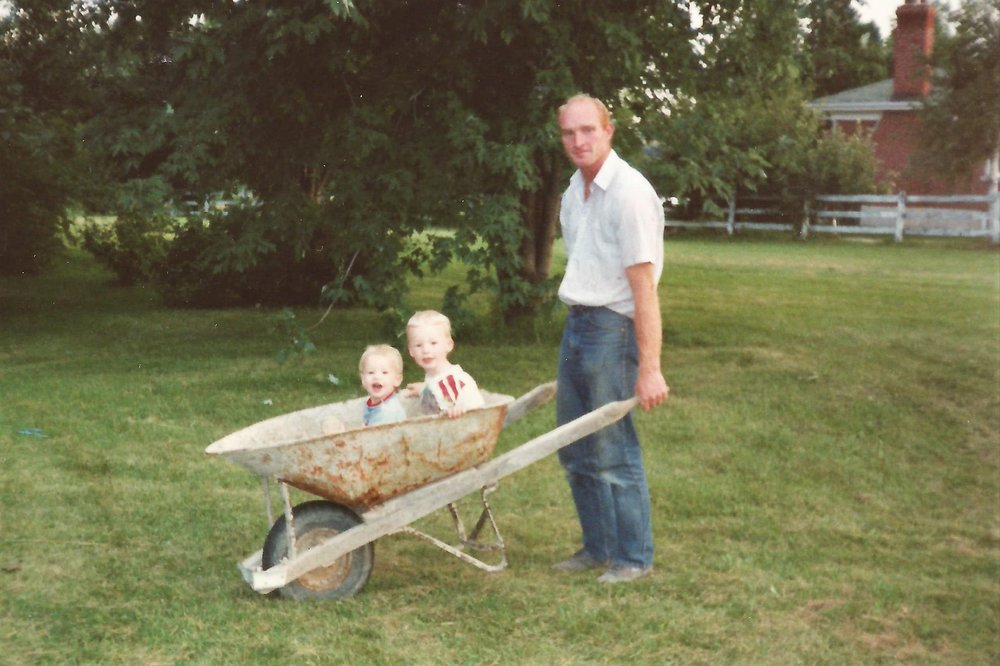 Taking the boys for a ride in the wheelbarrow.