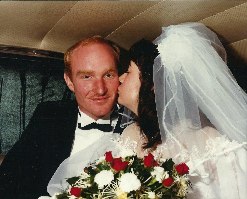Our wedding day, sitting in Ken's 1962 Thunderbird.