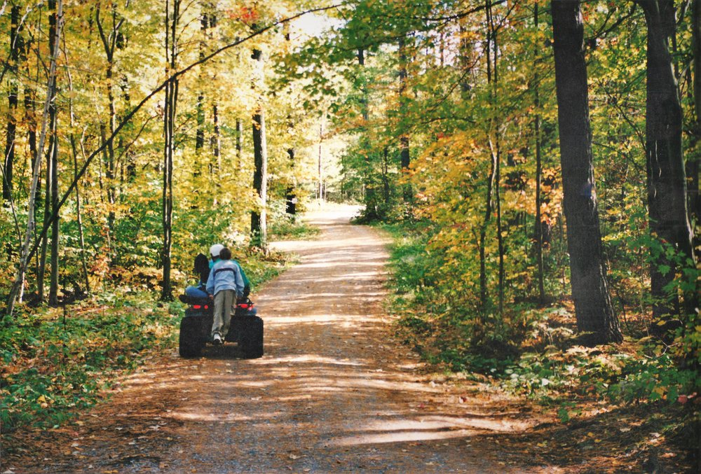 Ken taking James and his nephew for a ride on his ATV.