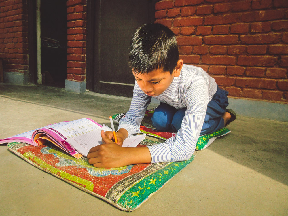 One of the students enjoying studying out in the sunshine.