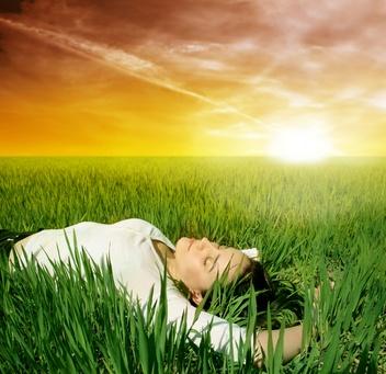 woman_laying_grass_sun_horizon.jpg