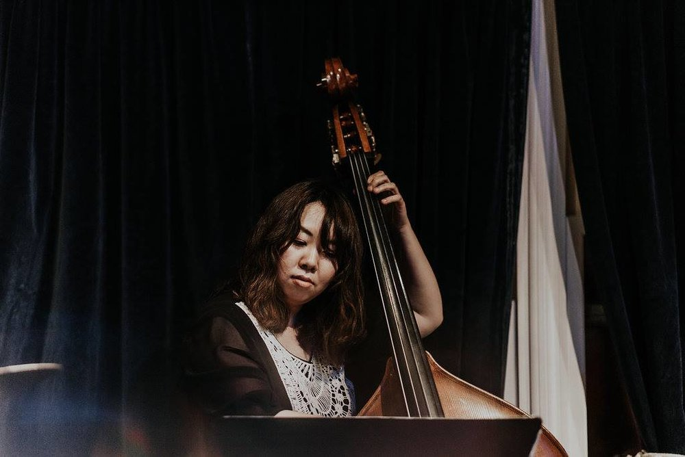 Rei Bowen - Bass - Rei Bowen is back on upright bass! She's also headlining the Blue Door's Tuesday Night Jazz Series on April 30th, and you can get tickets by clicking the button below.