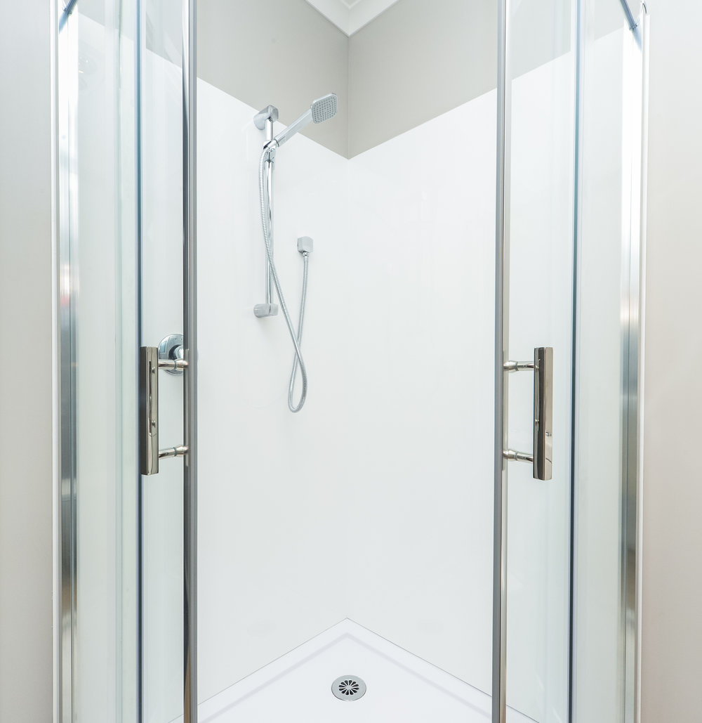 curved shower with greens slide.jpg