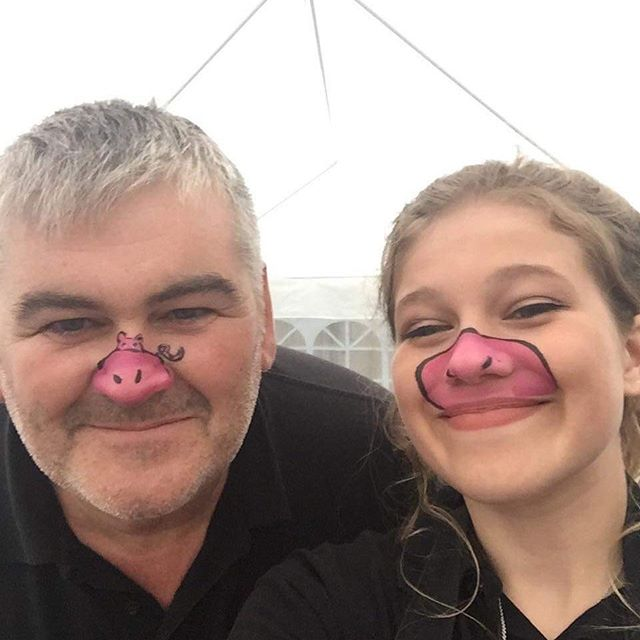 Just had our faces painted, ready to serve food at a birthday party... 🐽🐷