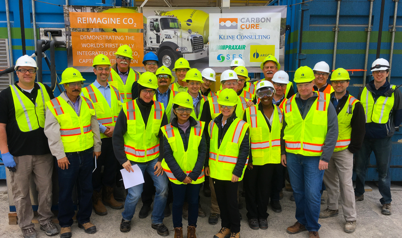 Team members from CarbonCure, Praxair, Argos, SES, and Kline Consulting welcome guests on-site at the demonstration site in Calera, Alabama in January 2018.