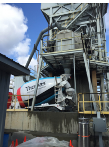 The CarbonCure technology precisely injects an optimized dose of liquefied CO2 from a pressurized tank directly into a central mixer or truck at a dry batch plant.