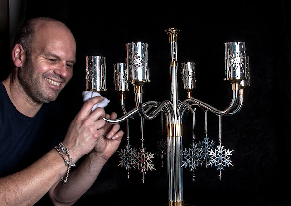 Finishing touches - Mark Hussey with the candelabra.