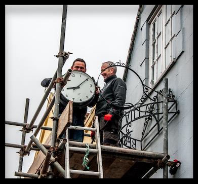 Workmen removing the clock