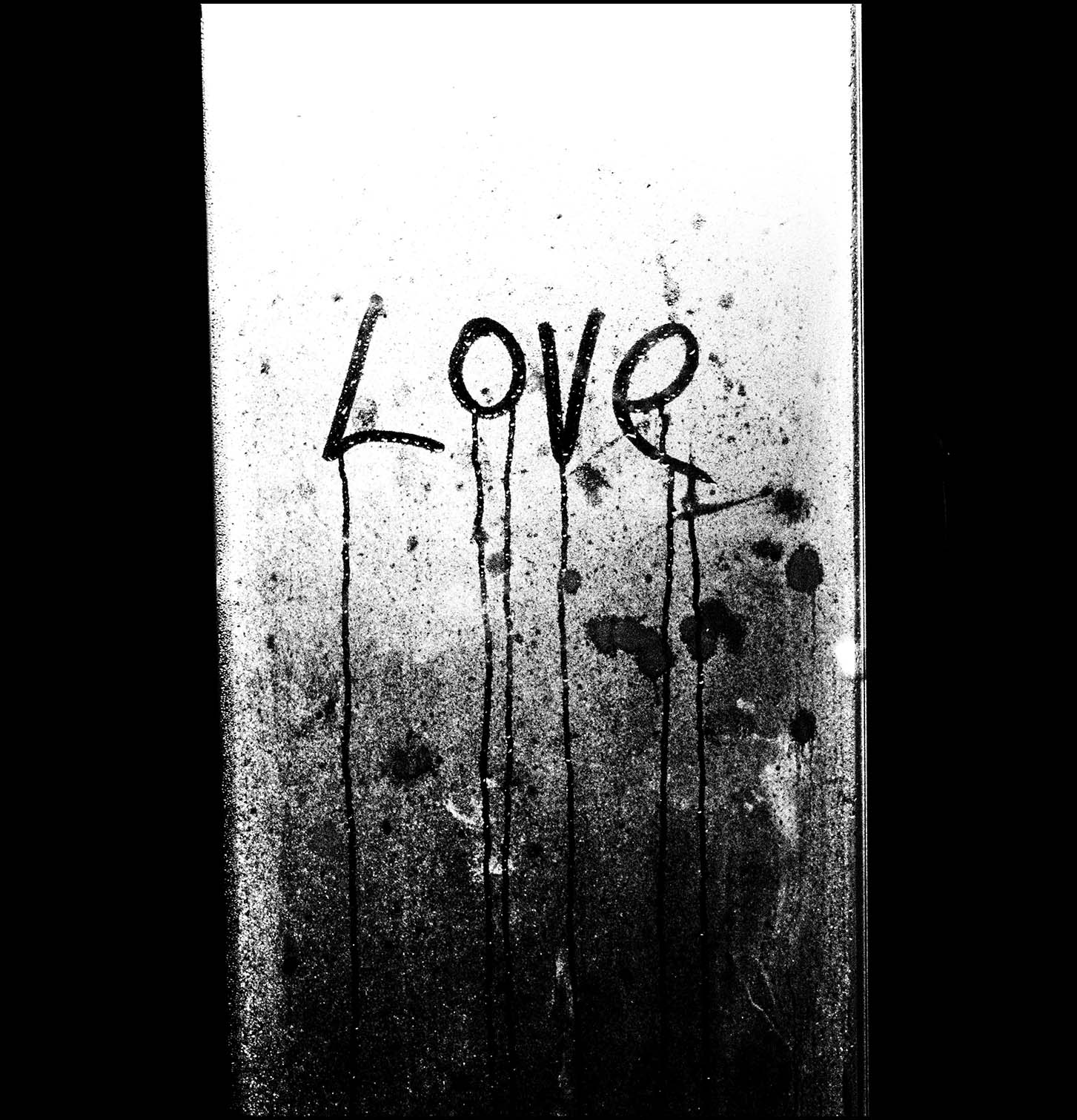 LOVE written on a condensated window