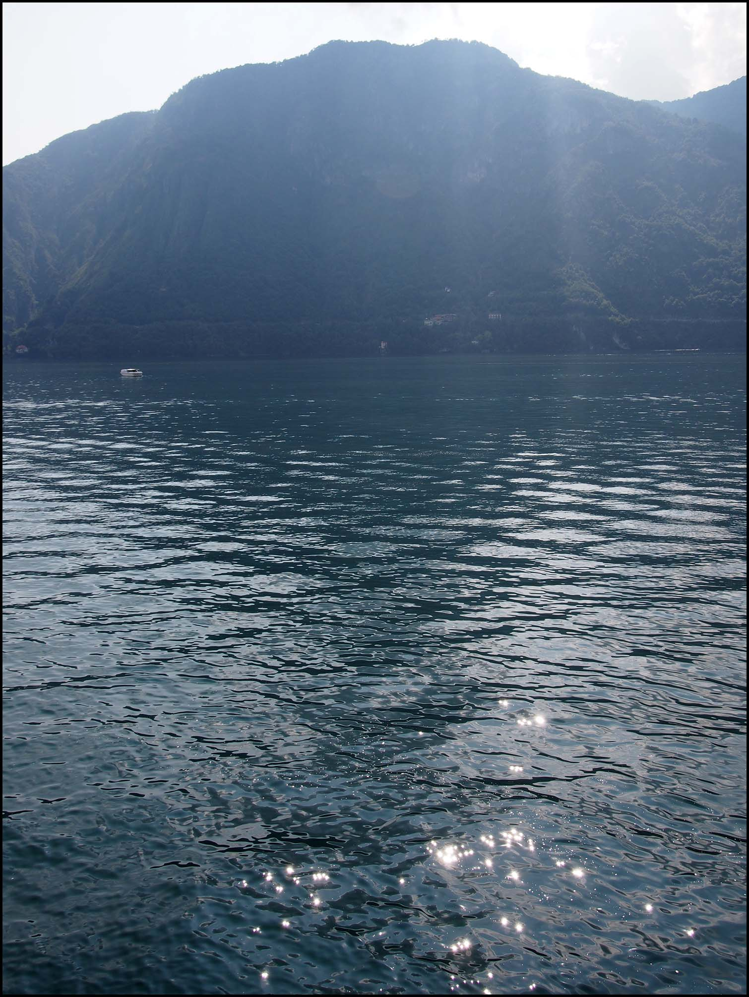 Sun shimmering on Lake Como
