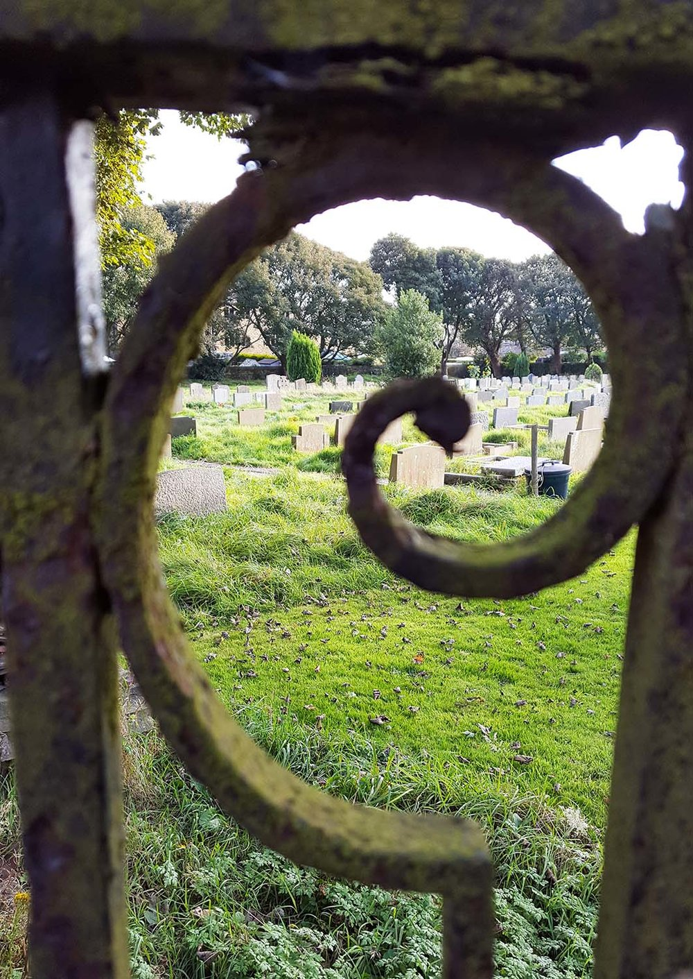View through the gate to the graveyard where Sylvia Plath is buried