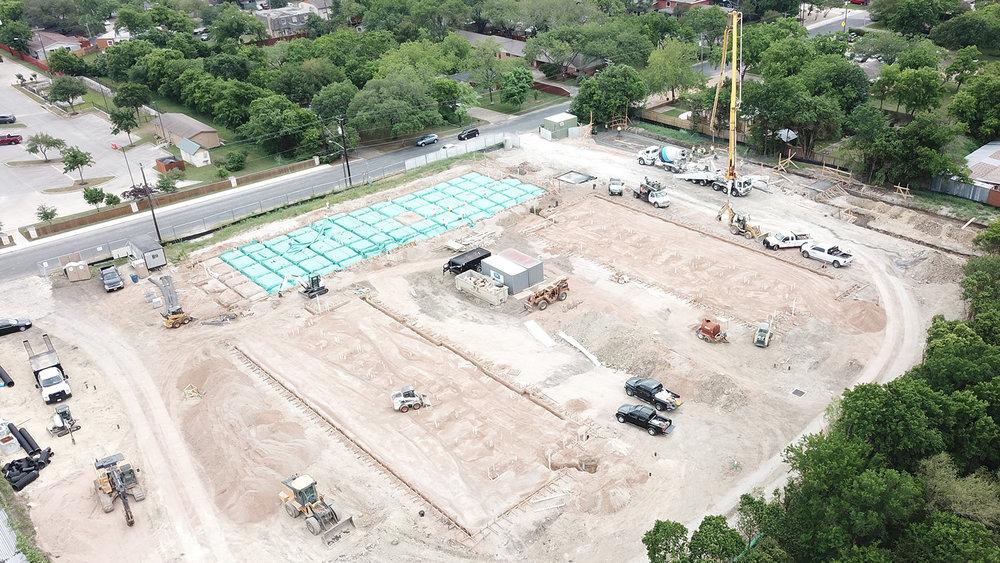 Site aerial showing Building 1 slab pour