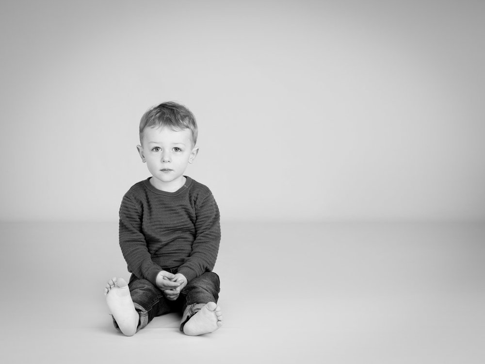 Little boy sat down for his photograph