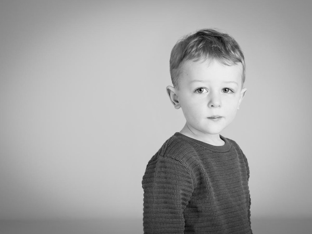 Little boy looking serious for his photography