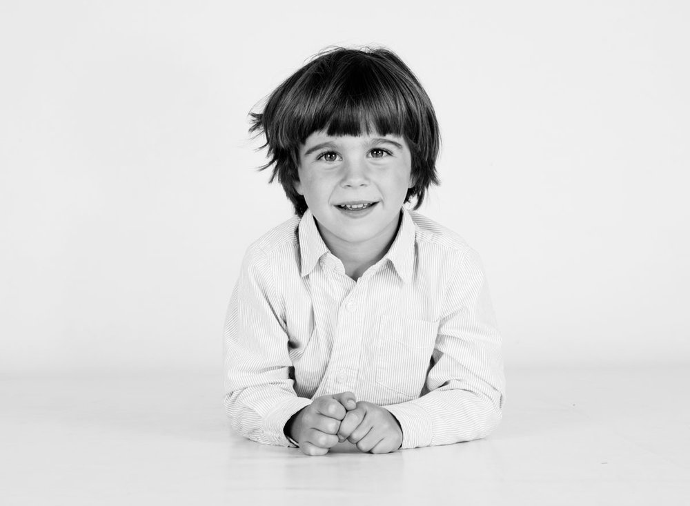 Boy smiling for his portrait photography