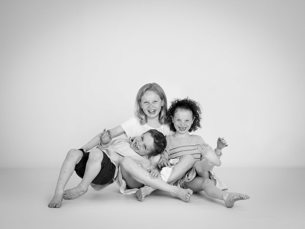 siblings playing together in the studio