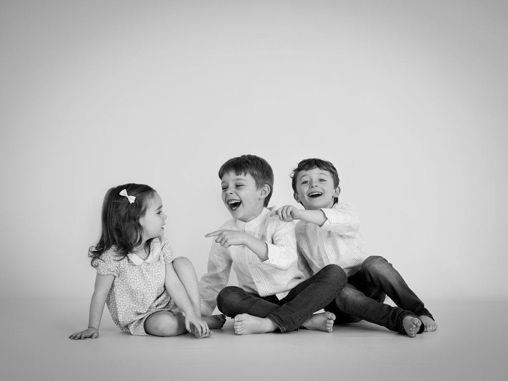 boys laughing at their younger sister