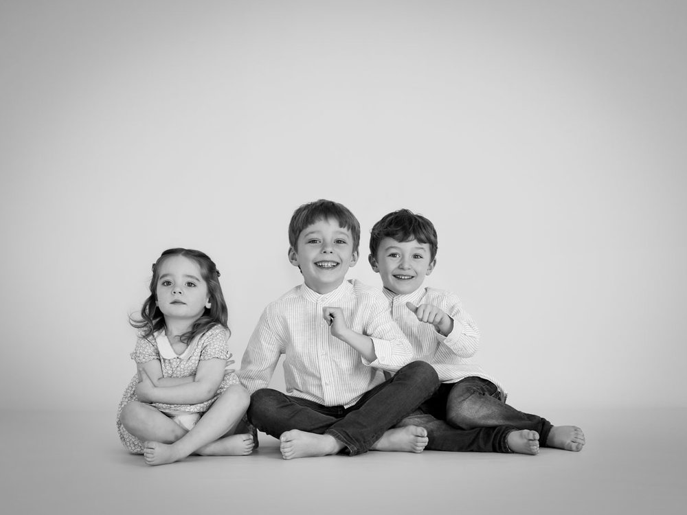 photoshoot of three siblings