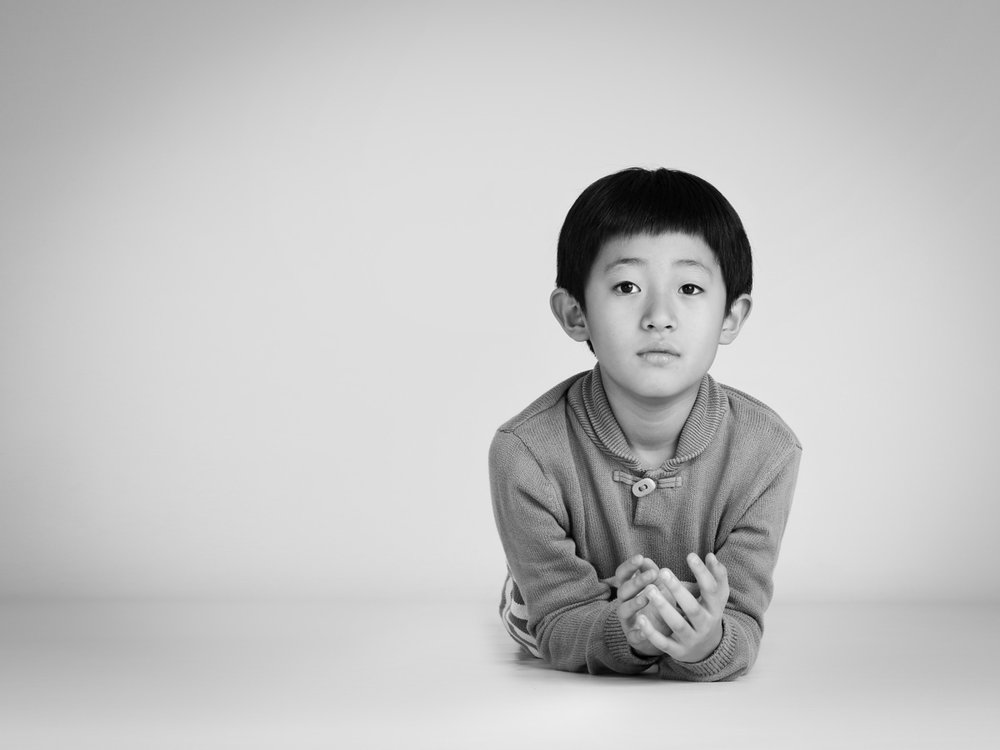 Calm family portraits of boy