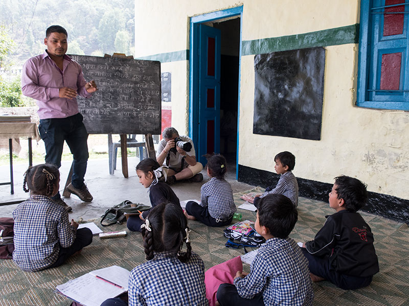 This school teacher in the Himalayas kindly let me sit in on his class and photograph the children.
