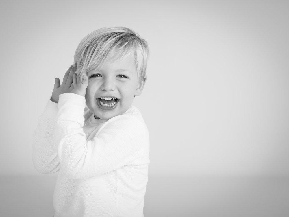 Blonde boy laughing