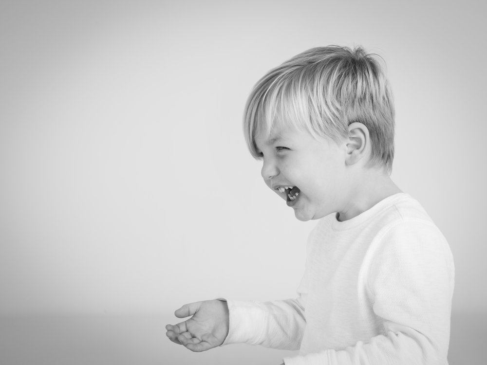 Toddler looking amused during his photograph