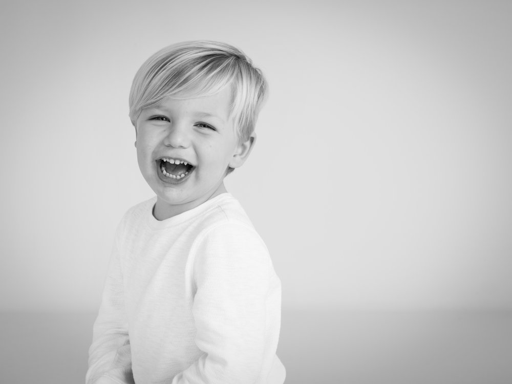 Little boy laughing during his portrait