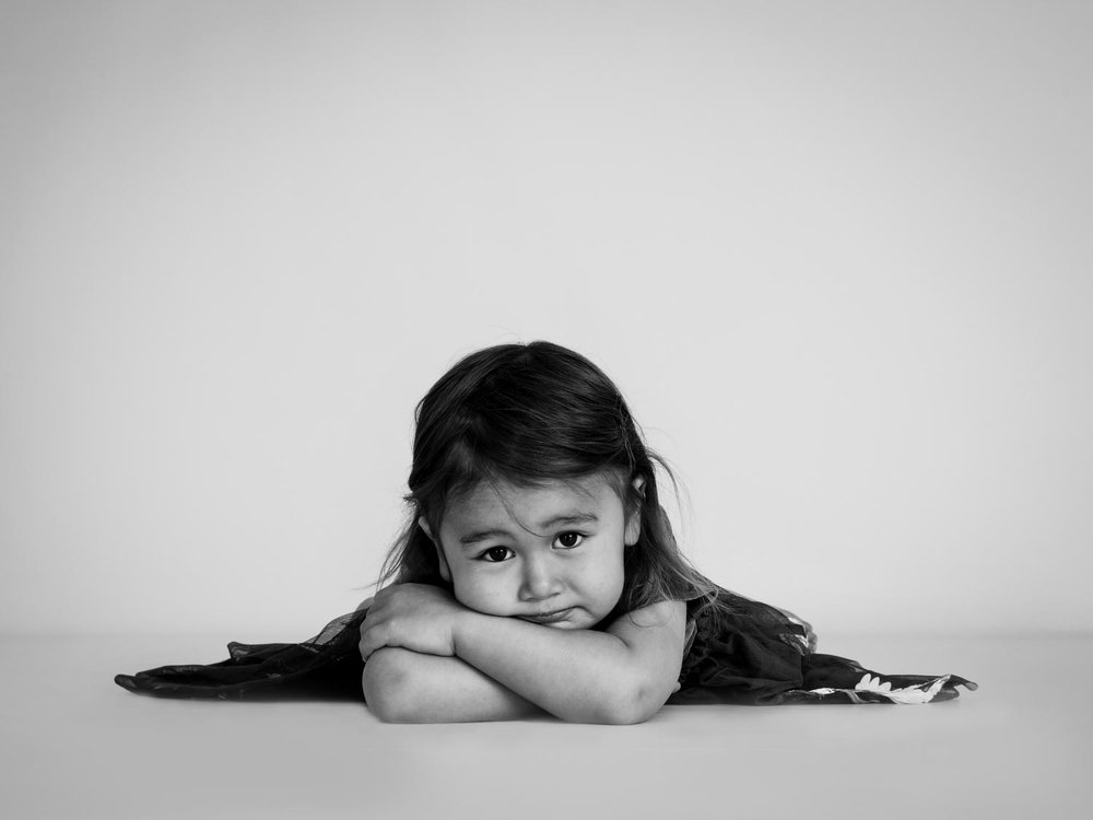 little girl lying on studio floor