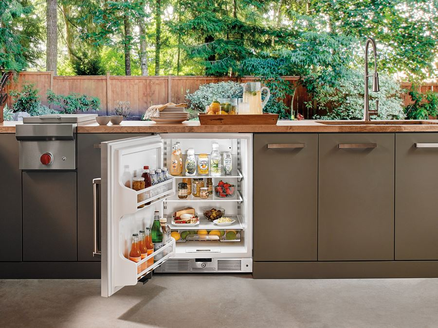 """24"""" OUTDOOR UNDERCOUNTER REFRIGERATOR - STAINLESS DOOR - UC-24RO     The UC24RO delivers a generous 5.7 cu. ft. of storage. An easy-access touch control panel adjusts temperatures from 34°F to 45° F, helping keep food fresher longer. Organization is easy, with adjustable spill-proof glass shelves, clear utility bin for smaller items, and two-liter bottle storage in the door. Bright interior lighting makes everything easy to spot, even at night. And the stainless steel door with pro handle is a perfect match for any Wolf outdoor grill."""
