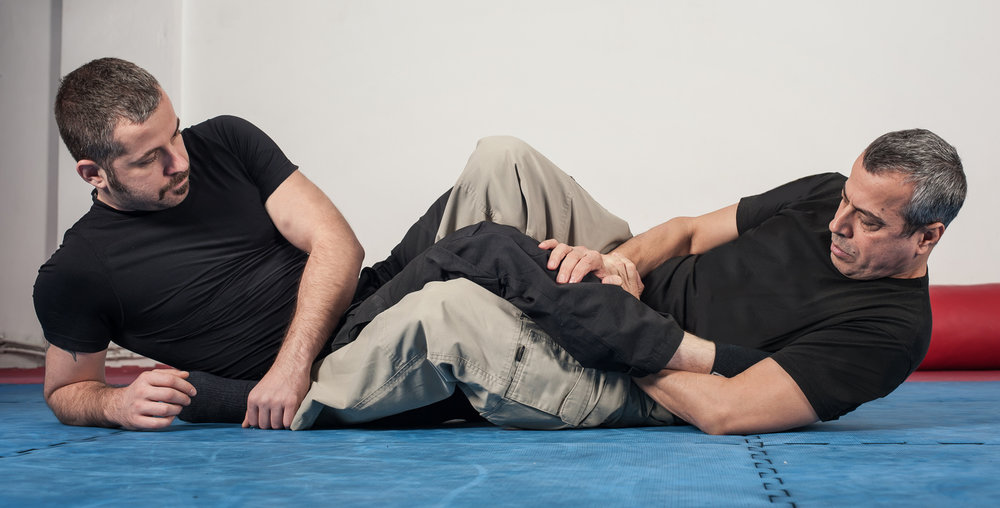 Ground Combatives - The majority of fights go to the ground. For a police officer, there are several reasons why this is not ideal. This program teaches officers how to effectively defend themselves from ground attacks with an emphasis on getting back up!