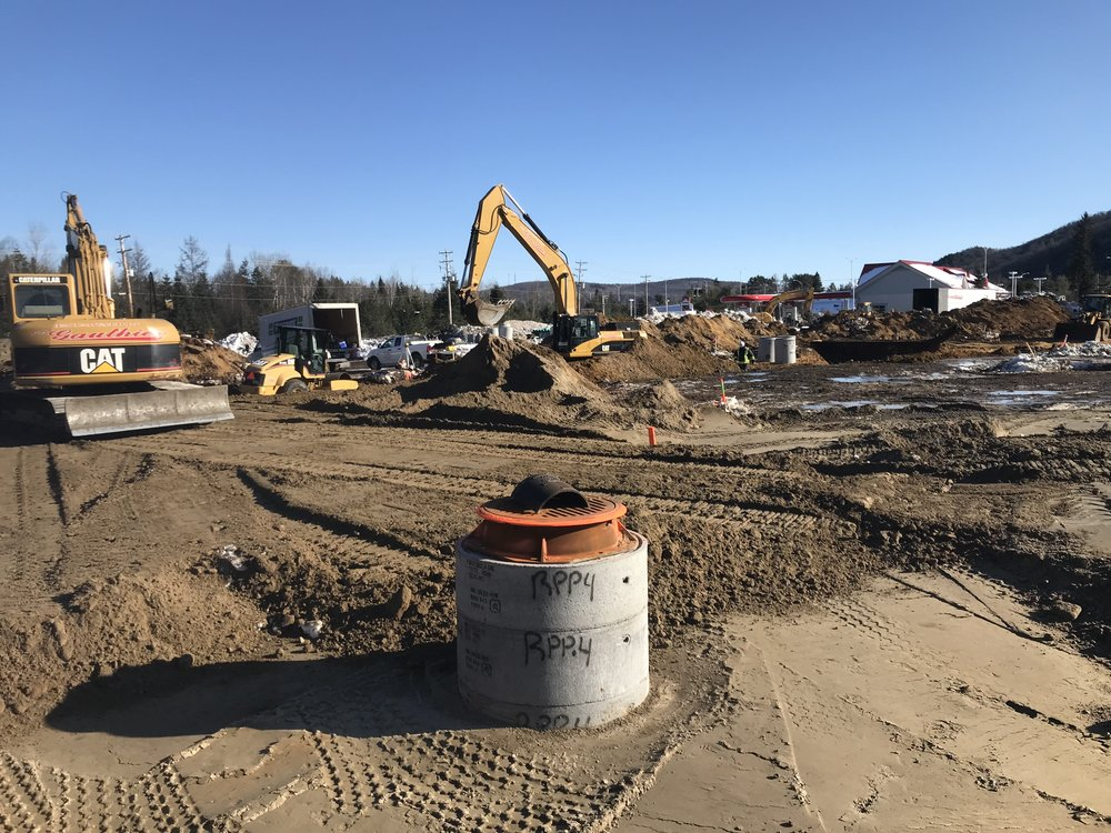 - Manholes already installed in the northeast sector of the site, between Building C and the hotel.
