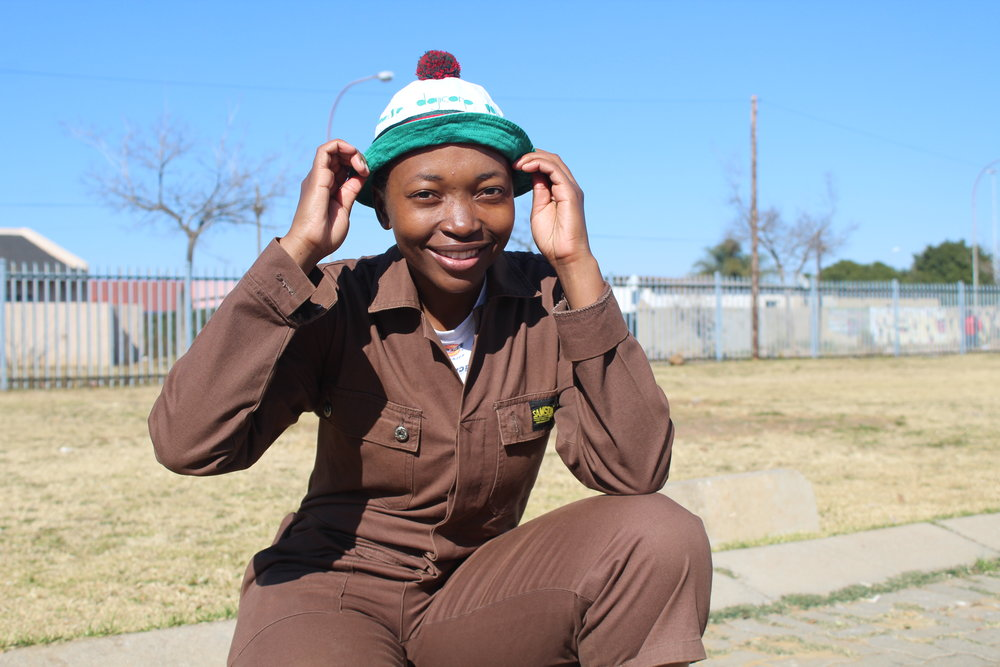 "COLORFUL UNIFORMS OF BUCKET HATS AND CONVERSE ARE TYPICAL CLOTHING OF PANTSULA DANCERS. CREDIT: LEBALLO ""LEE"" LENELA"