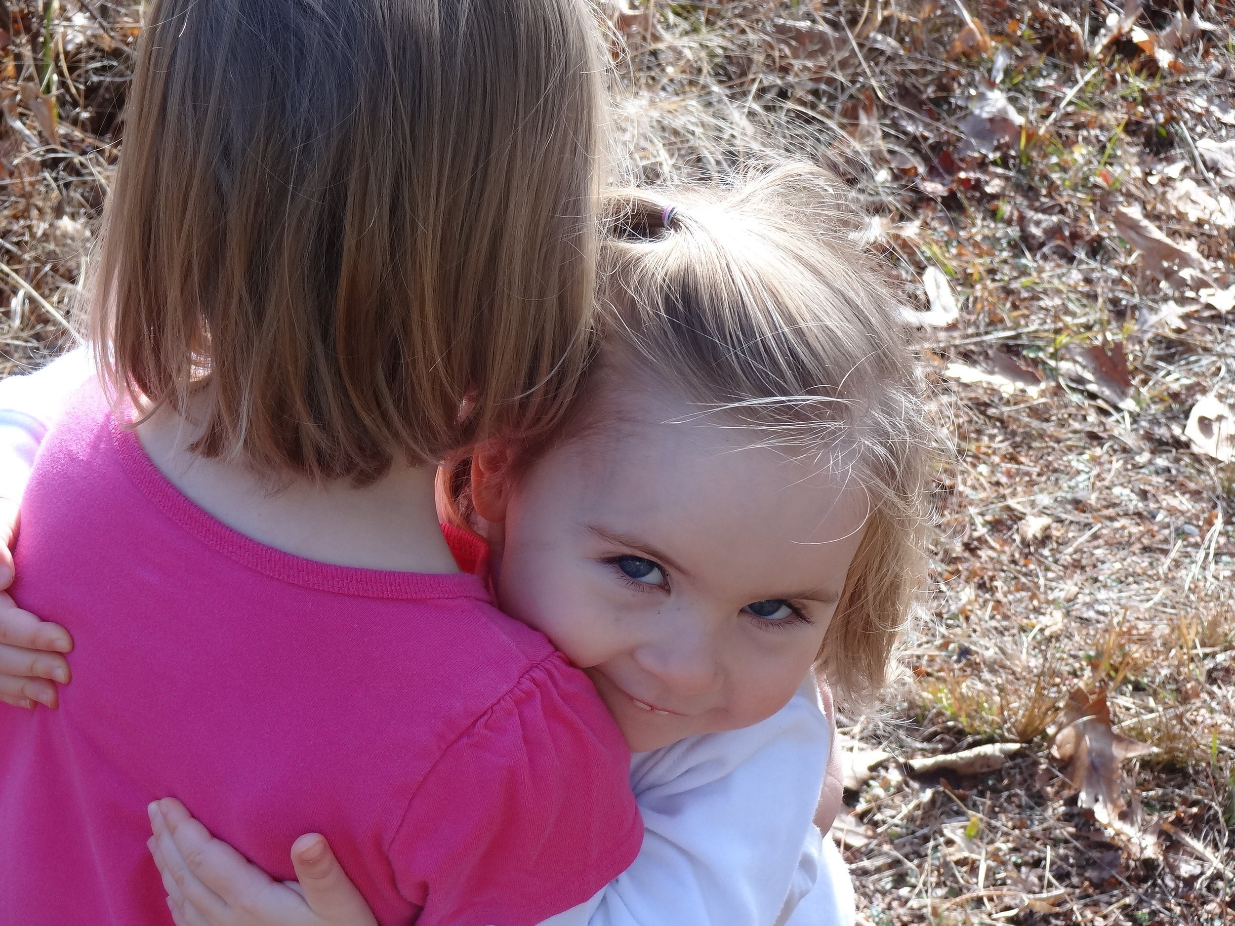 Sweet hugs between children.