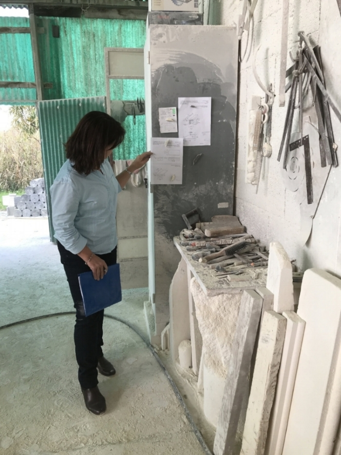 Jane Kennelly in Italy reviewing stone