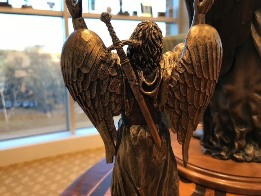Client's inspiration sculpture for wings on pedestals.jpg