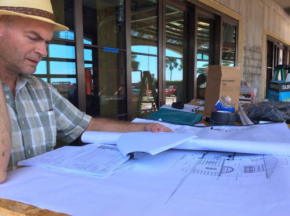 Seay studies his drawings.jpg