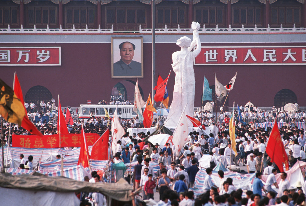 Students demonstrate against the rule of the Chinese Communist Party in Tiananmen Square