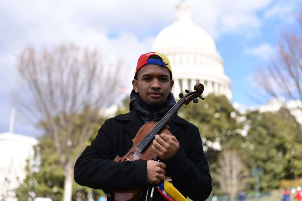 Wuilly Arteaga with the Violin given to him by the Victims of Communism Memorial Foundation