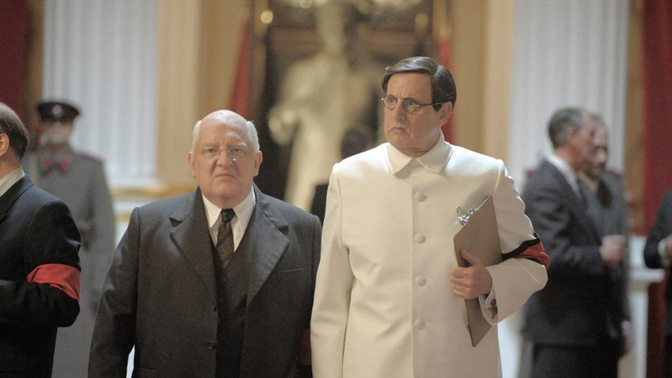 Lavrentiy Beria (left) and Georgy Malenkov scheme at Stalin's state funeral.  Photo: Quad Productions