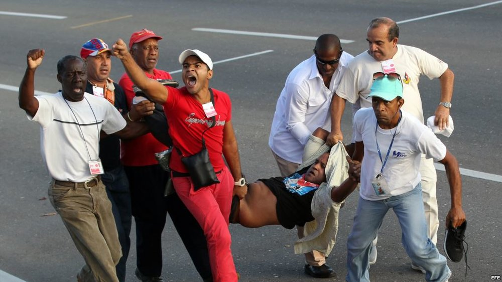 Protestor Daniel Llorente is dragged off of the street by Cuban State Security after disrupting the Worker's Day march.  Photo: Miami Herald