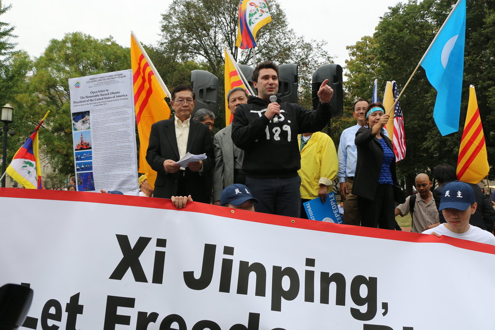 Director Smith addresses a crowd of protestors outside the White House during Xi Jinping's 2015 visit to Washington.