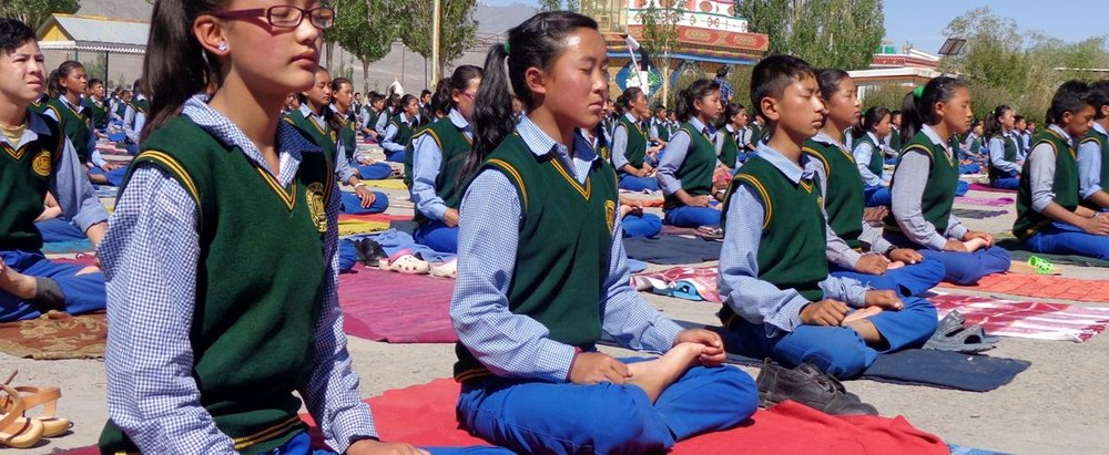 Students at the Tibetan Children's Village practice the traditional techniques of Tibetan Buddhism.