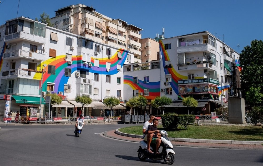 This painted tenement on Wilson Square, named after the American president, is one of many in Tirana.This painted tenement on Wilson Square, named after the American president, is one of many in Tirana.